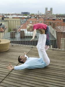 Dad with Daughter balanced on feet